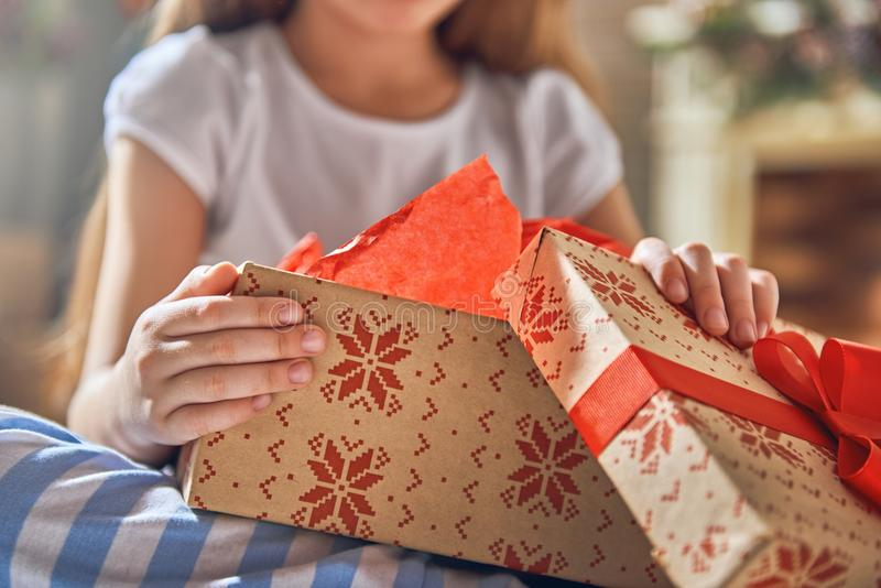 Child opening gift stock images