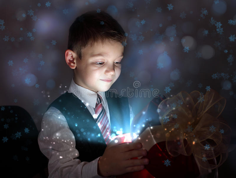 Child Opening A Magic Gift Box Royalty Free Stock Photography