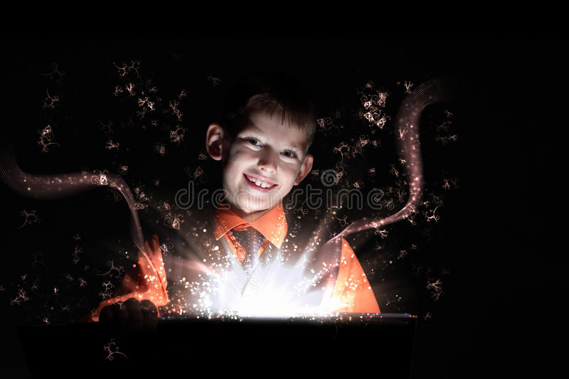Child opening a magic gift box royalty free stock image