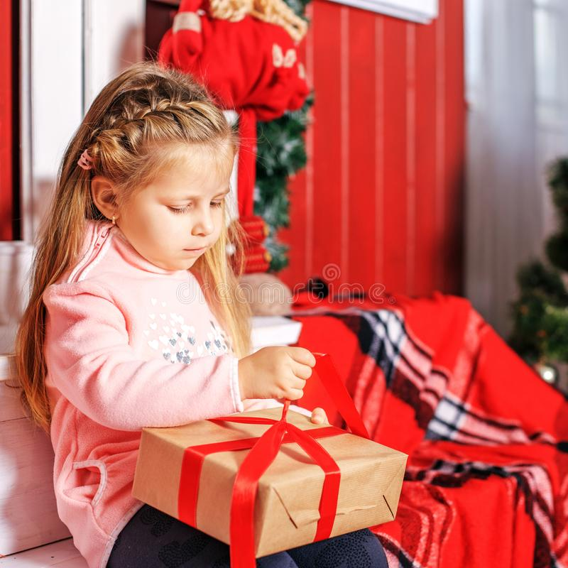The child opens a present. Concept New Year, Merry Christmas, ho. Liday, vacation, winter, childhood stock photography