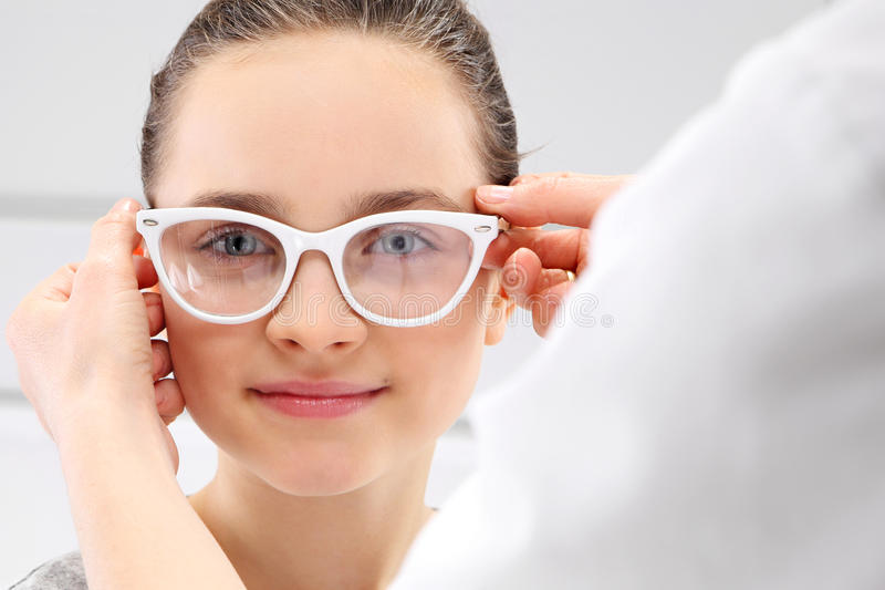 Child an ophthalmologist stock image