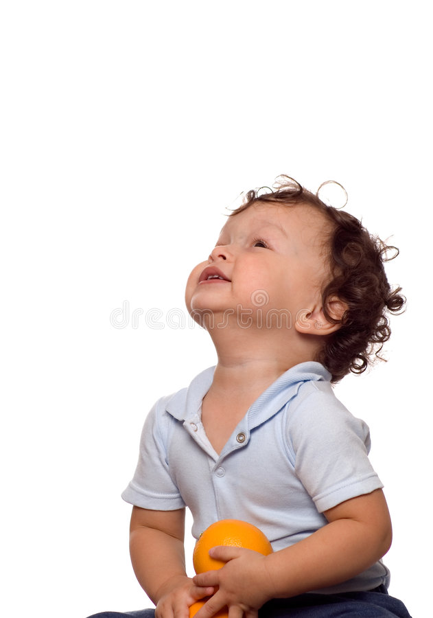 The child with orange. royalty free stock images