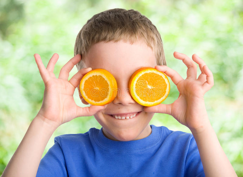 Child with an orange stock photography