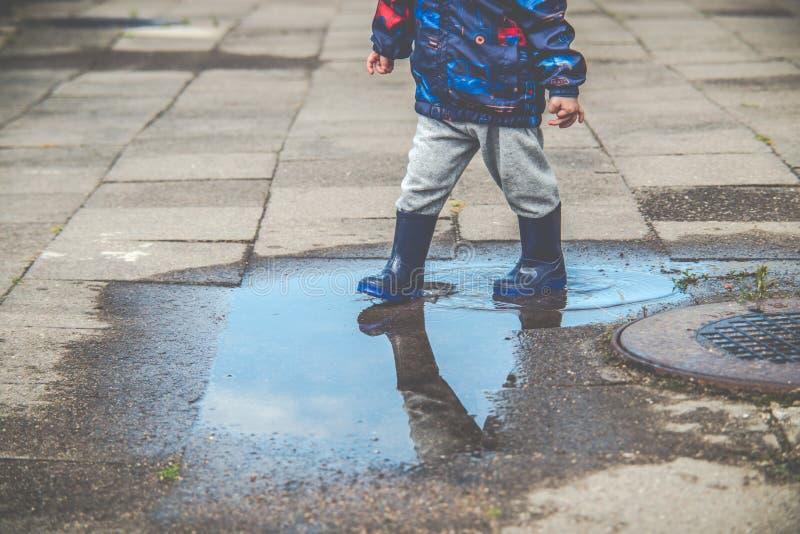 Child outdoors after rain stock photos