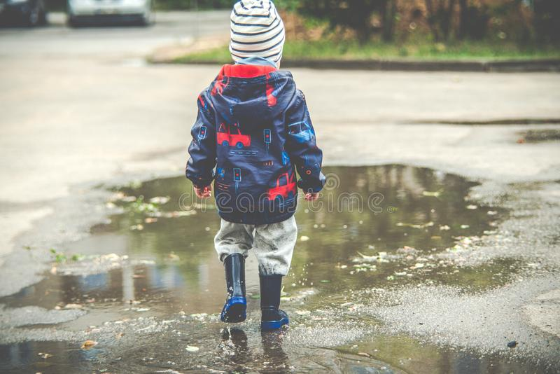 Child in puddle royalty free stock photo