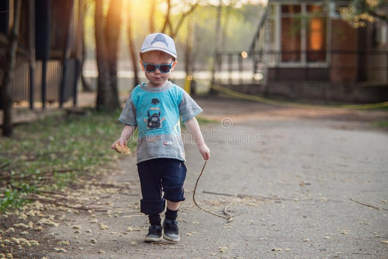 Little boy walking alone royalty free stock images