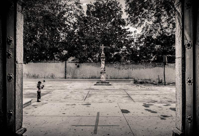 Child Outside the Cathedral of San Gervasio royalty free stock image