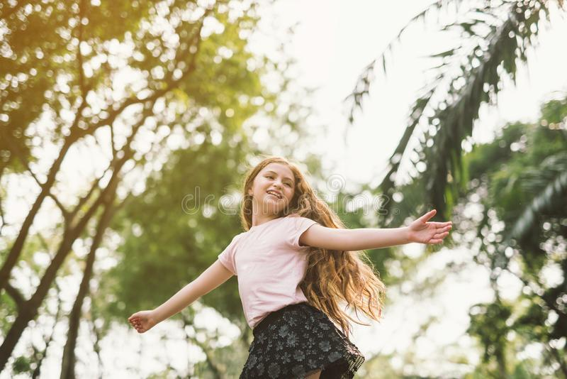 Child outstretched arms enjoying freedom stock images