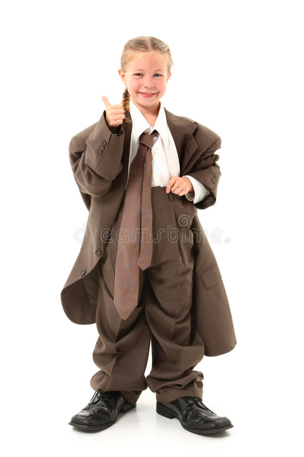 Child in Oversized Suit. Beautiful american four year old girl dressed in oversized business suit stock photography
