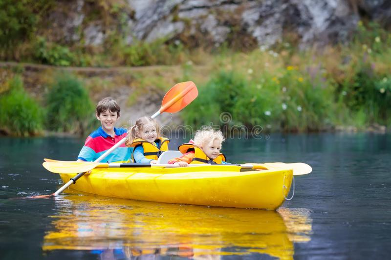 Child on kayak kids on canoe summer camping stock image for Fishing camps for kids
