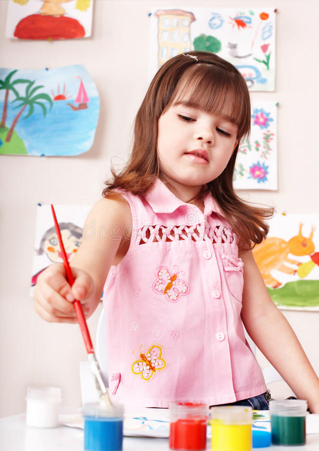 Child with paint in art class . Preschool royalty free stock photography