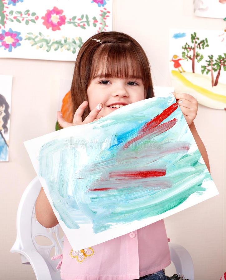 Child paint picture in preschool. Little girl paint picture in preschool royalty free stock photos