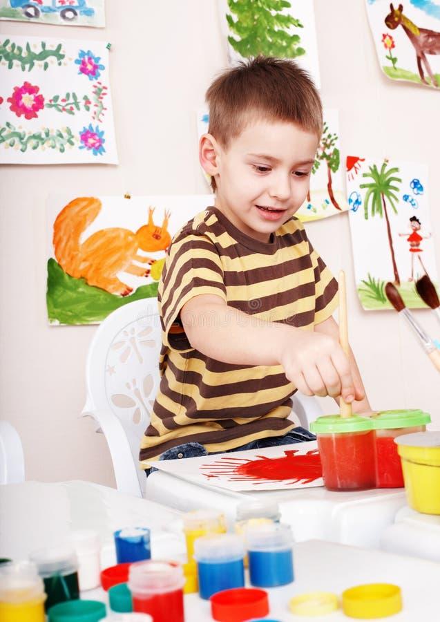 Child paint picture in preschool. Little girl paint picture in preschool royalty free stock photography