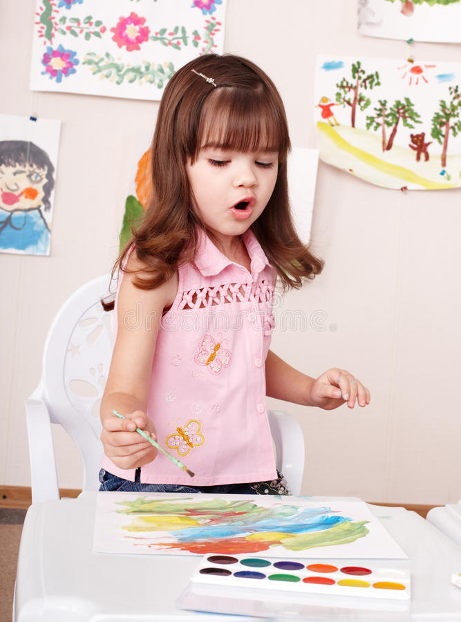 Child paint picture in preschool. royalty free stock image