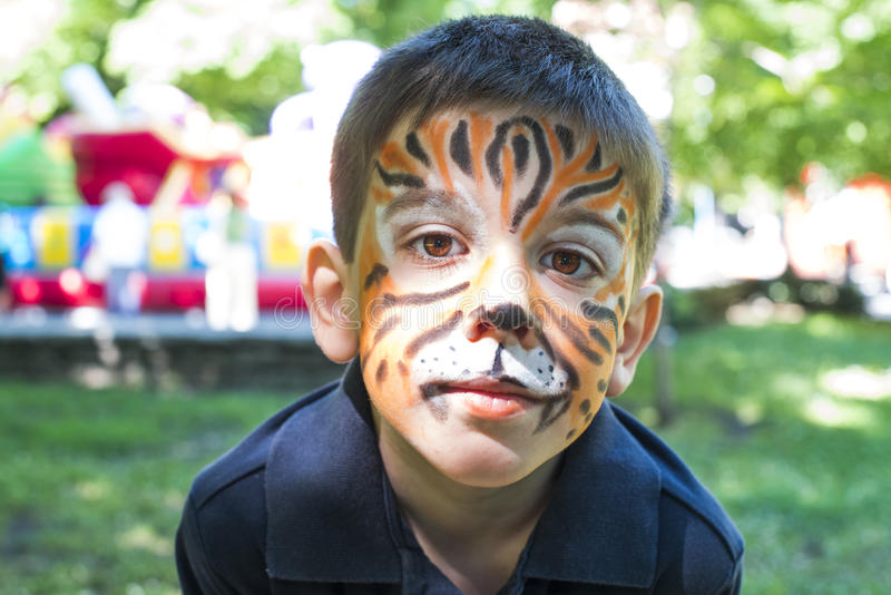 Child With Painted Face Stock Photo