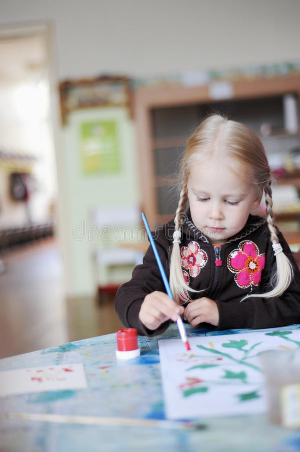 Child painting stock image