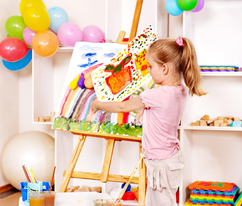 Download Child painting at easel. stock photo. Image of learning - 26060346