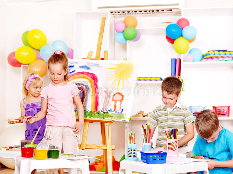 Download Child painting at easel. stock image. Image of nursery - 26141605