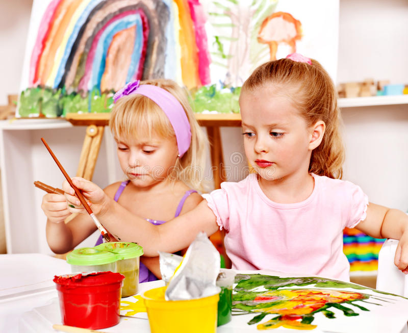 Child painting at easel. royalty free stock photos