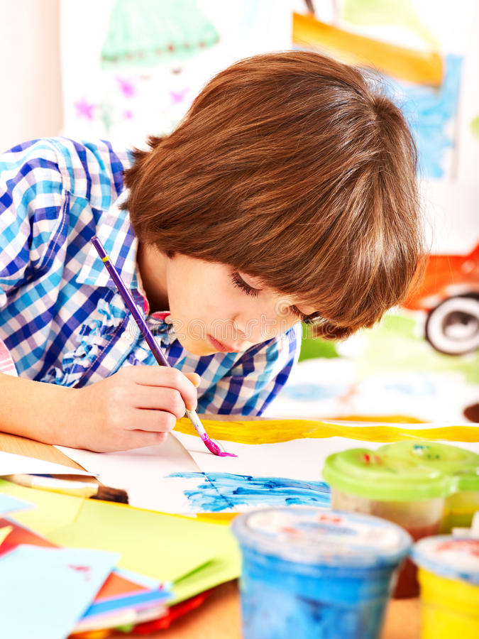 Download Child painting at easel. stock photo. Image of craft - 28880634