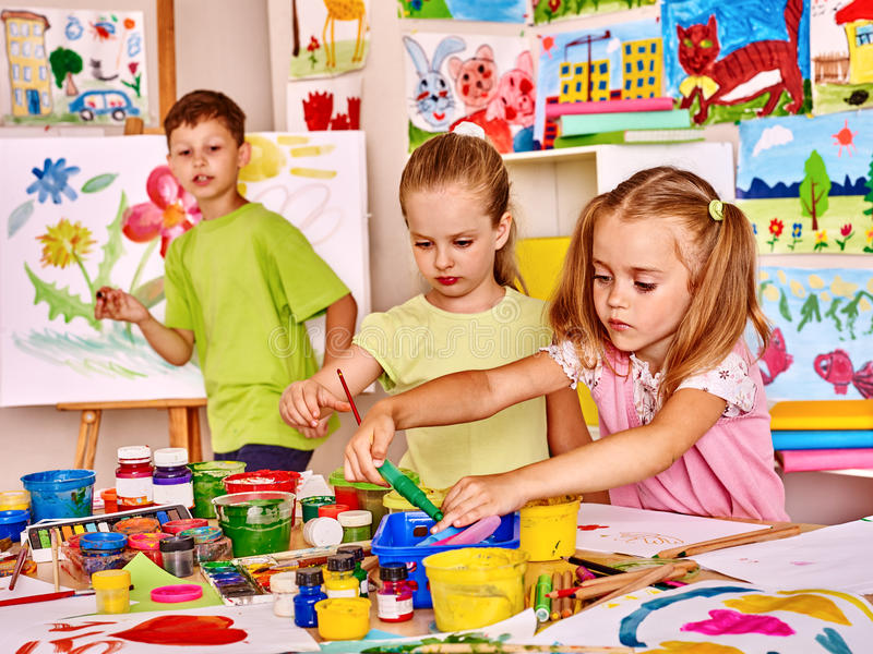 Child painting at easel royalty free stock images