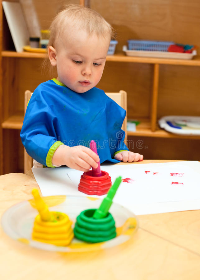 Download Child at painting lesson stock photo. Image of image - 13482186