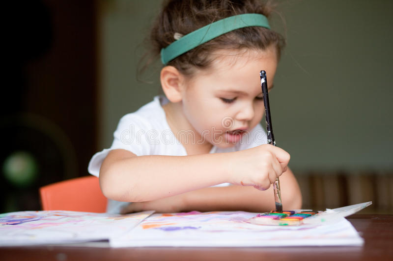 The child painting a picture royalty free stock photo