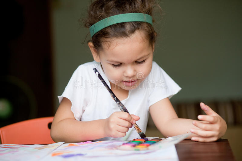 The child painting a picture royalty free stock photos