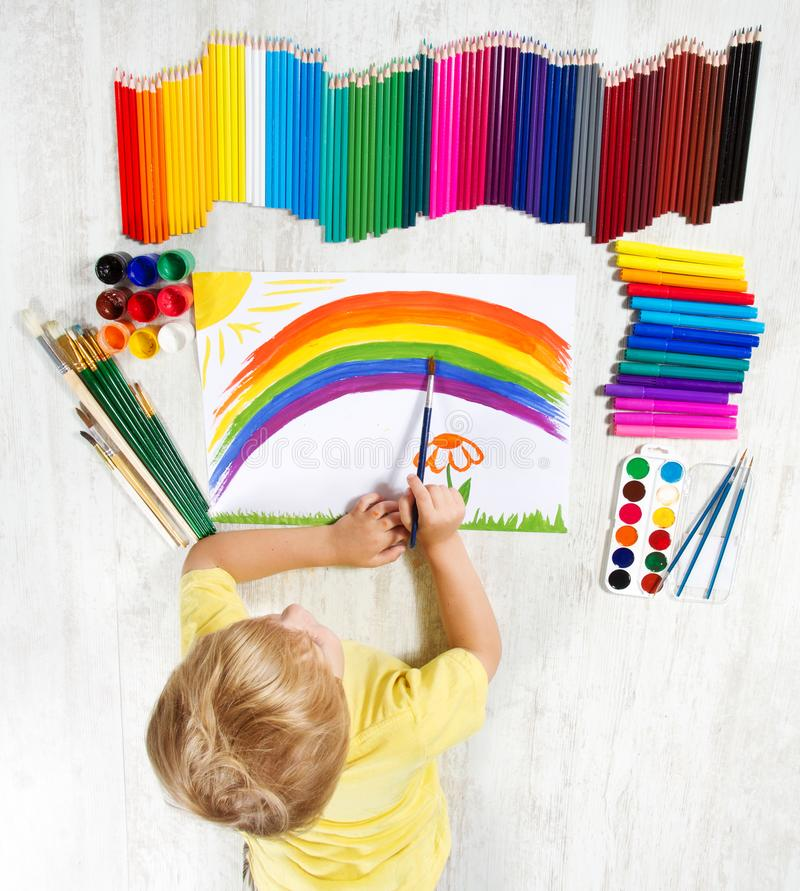 Child Painting Rainbow by Brush Colors, Creative Kid Artist stock photos