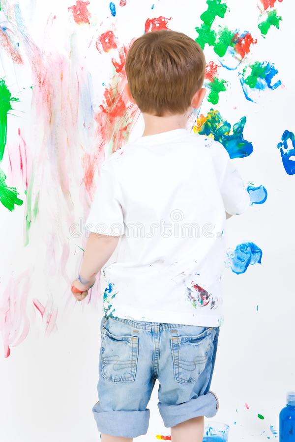 Child painting on the wall royalty free stock photos