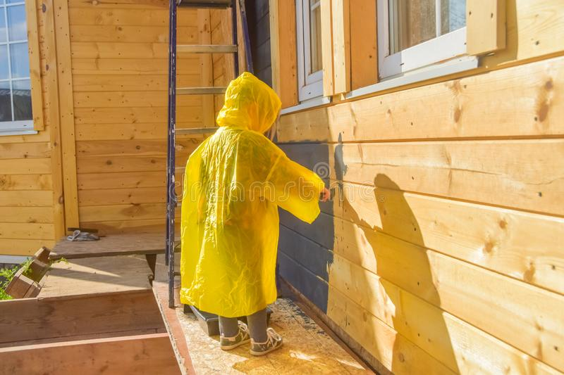 Child paints a house brush out stock images