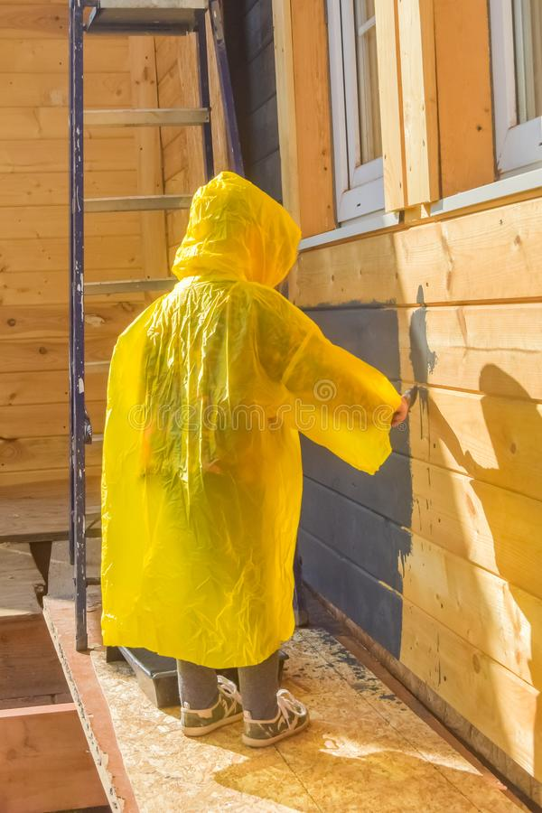 Child paints a house brush out stock photos