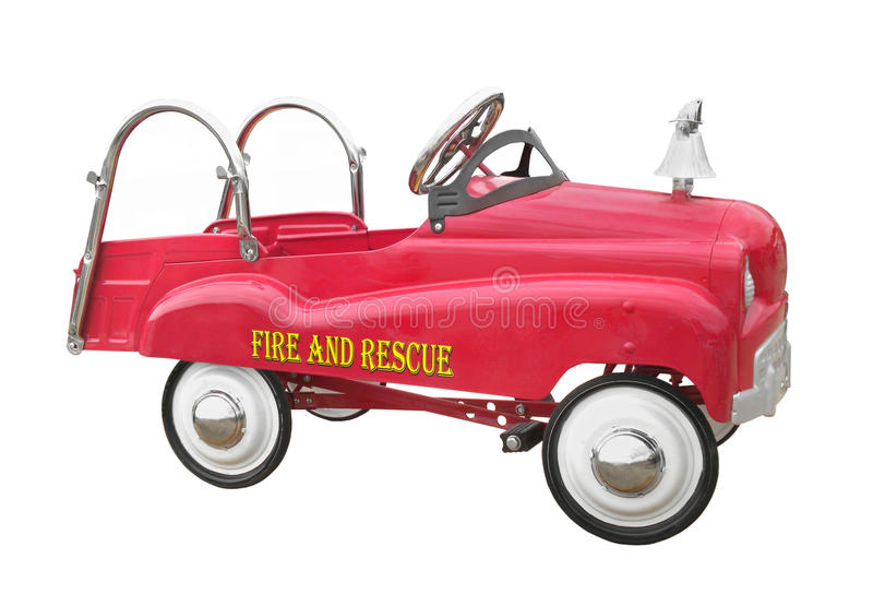 Child pedal fire truck isolated. Vintage child's pedal fire and rescue truck. Isolated on white stock photography