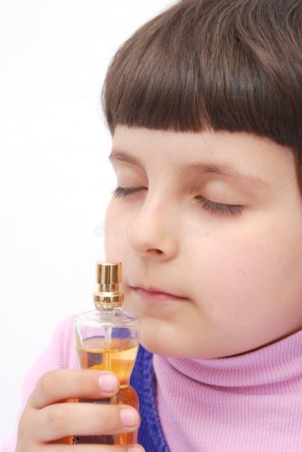 Child and perfume stock image