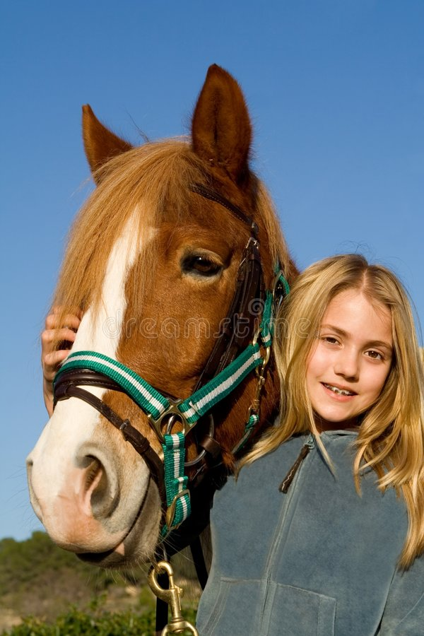 Child with pet horse royalty free stock image