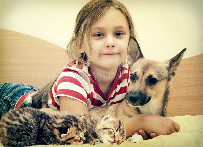 Child and pets royalty free stock photo