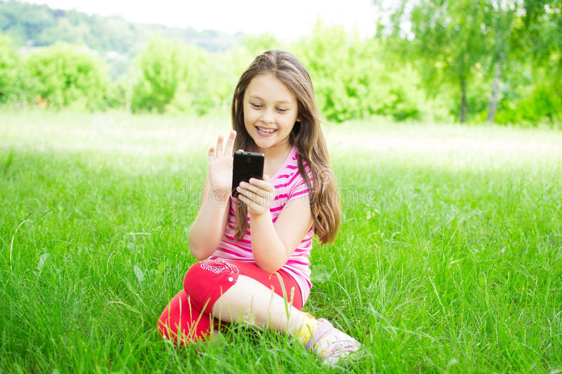 Child and phone stock photography