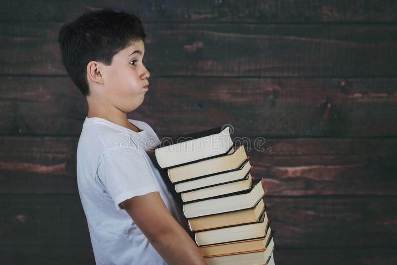 Child with pile of books royalty free stock photography