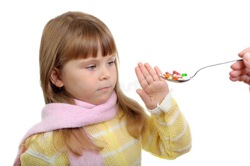 The child and pills royalty free stock image