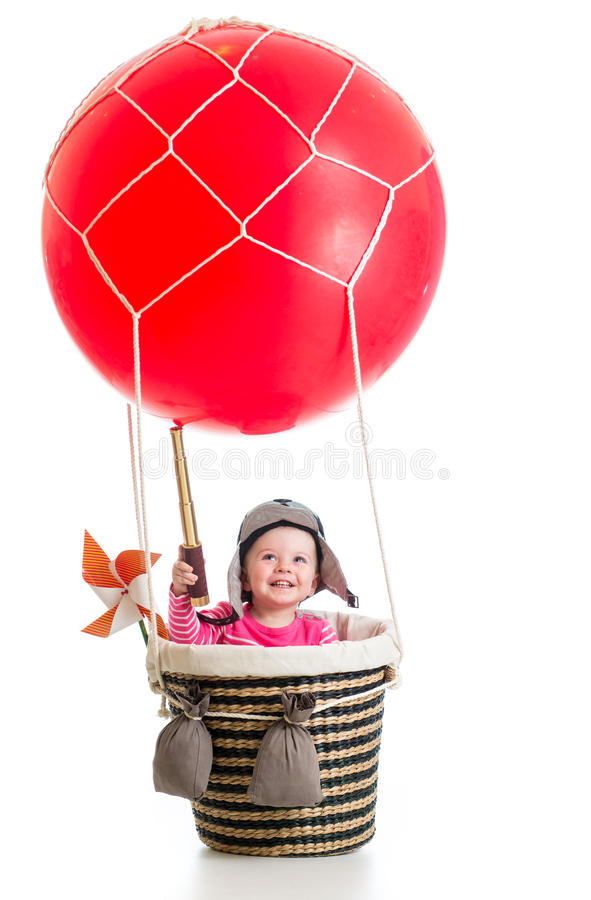 Child with pilot hat and teleskop on hot air balloon. Kid with pilot hat and teleskop on hot air balloon royalty free stock image