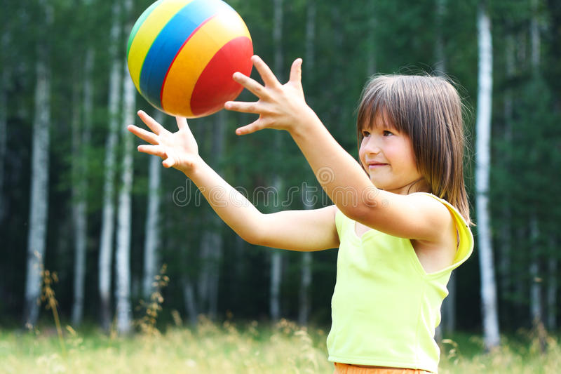 Download The child play with a ball stock image. Image of gravity - 15550971