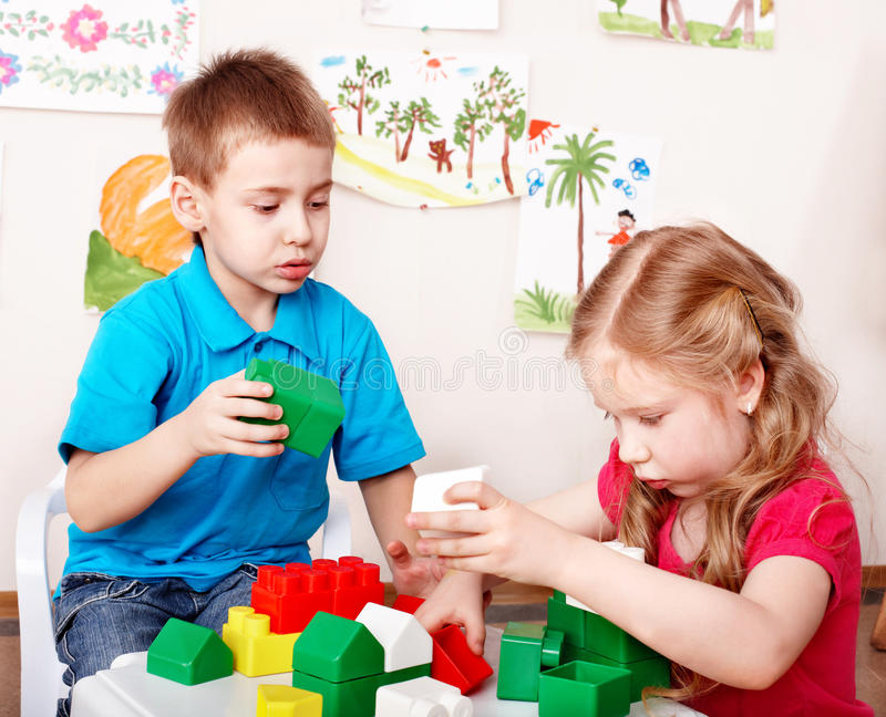 Child play construction set in classroom. . stock images