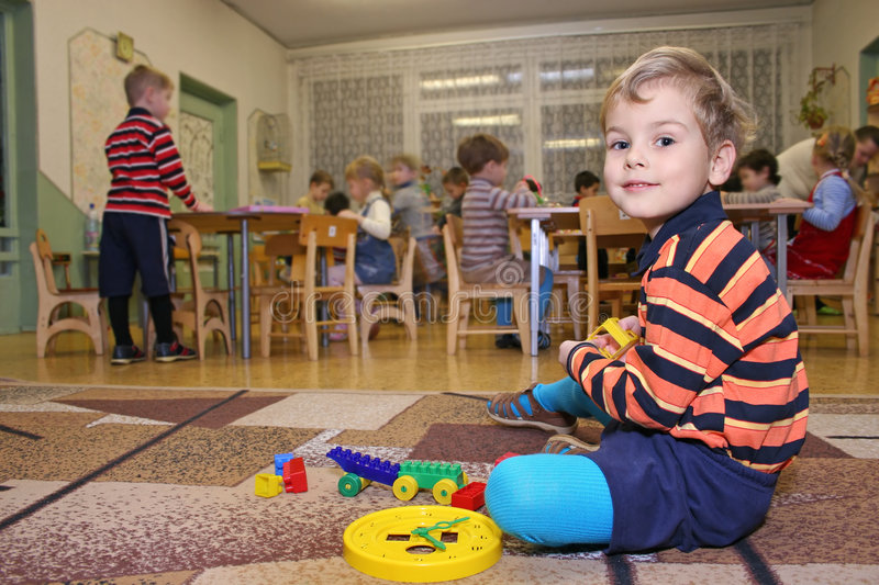 Child play in kindergarten stock images