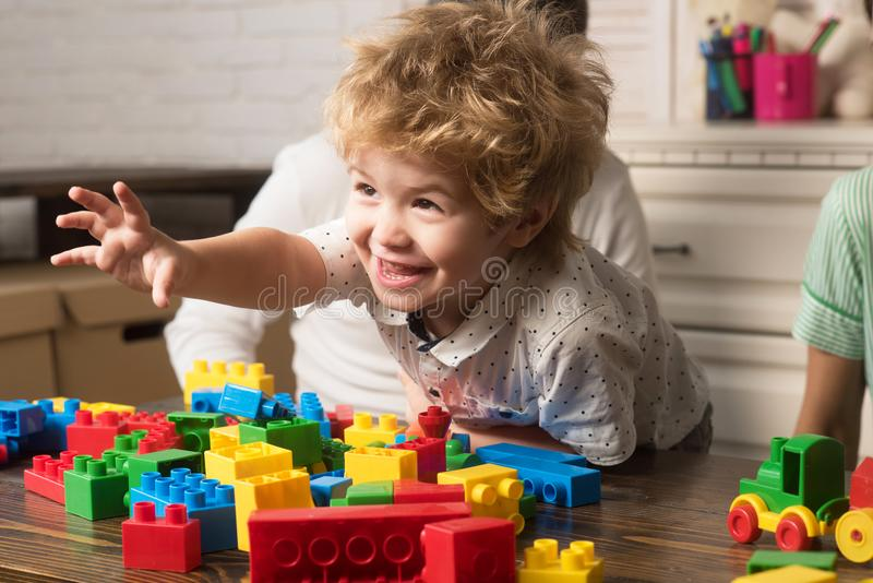 Child play with toy construction bricks. Family games concept. stock image