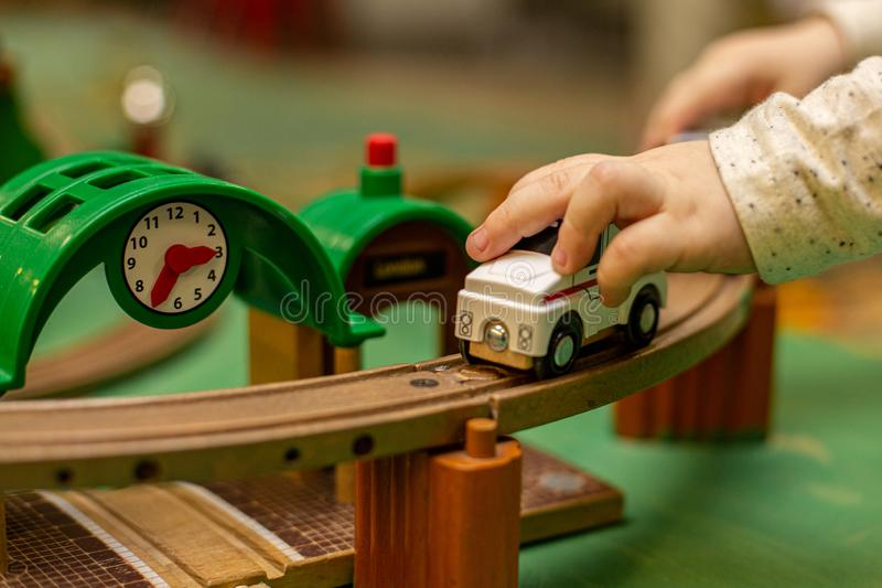 Child play with wooden train, build toy railroad at home or kindergarten. Toddler kid play with wooden train stock photos
