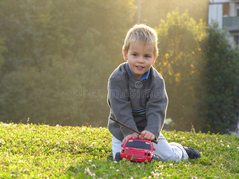 Child play wth car royalty free stock image