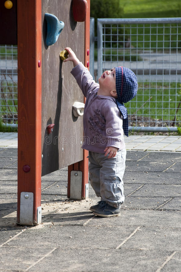 Child in playground stock photography