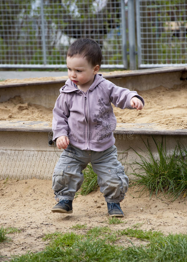 Child in a playground royalty free stock photos