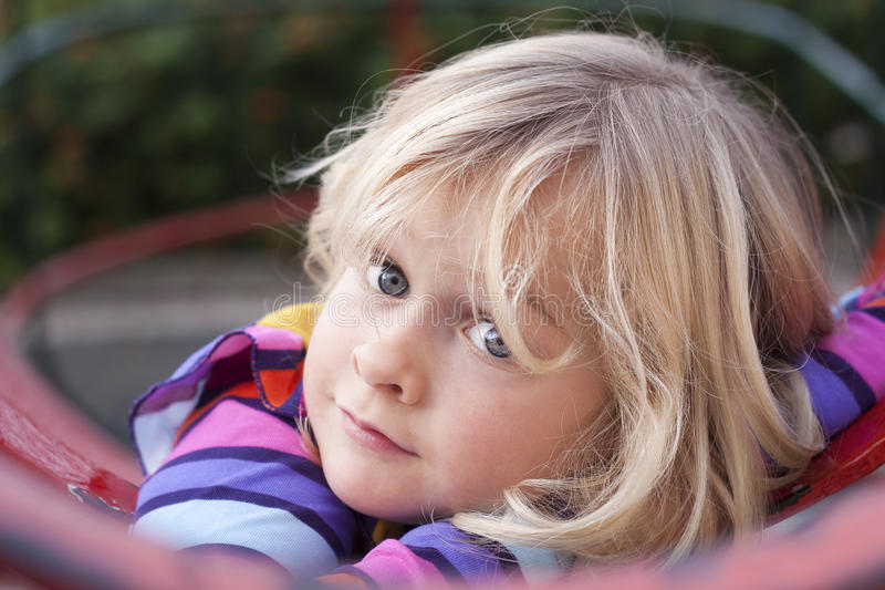 Child in playground royalty free stock photo