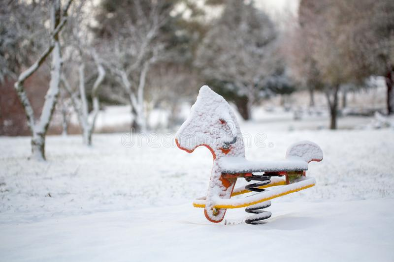 Child playground equipment covered in snow in Oberon stock photos